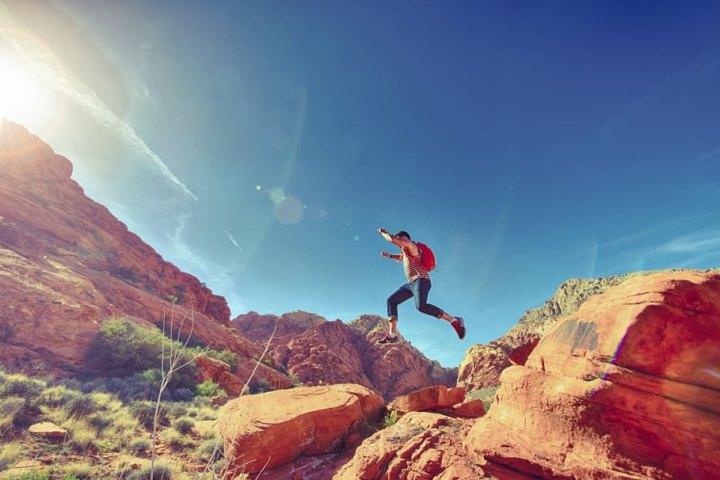 man-person-jumping-desert-uai-720x480